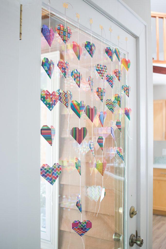 origami heart garland on window