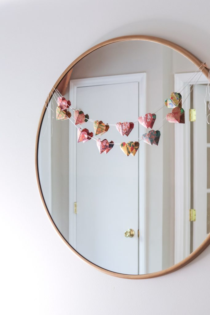 origami heart garland on mirror